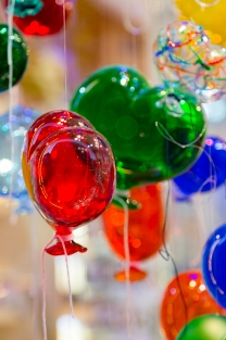 Balloons of Murano glass. Balloons made of Murano glass in the form of hearts. Colorful balloons made of Venetian Murano Glass.
