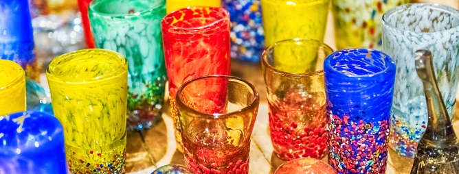 Traditional colorful murano glass goblets for sale in Murano island, Venice, Italy. The island is a popular attraction for tourists, famous for its glass making