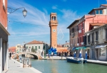 Old town of Murano island with houses and canal, Venice